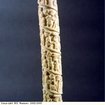 Carved ivory tusk, may show slaves or captives